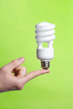 Person holding a modern green light bulb Stock Photography