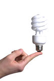 Person holding a modern green light bulb Royalty Free Stock Photos