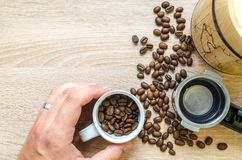 Person Holding Mug Filled With Coffee Beans Royalty Free Stock Photography