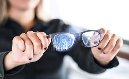 Person holding nanotech smart glasses. Eyewear with interactive augmented reality. Person holding nanotech smart glasses. Eyewear with interactive augmented royalty free stock images