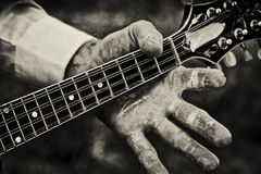 Person Holding Neck of a Mandolin Stock Image