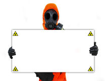 Person holding nuclear hazard sign Royalty Free Stock Images