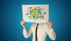Person holding paper with design thinking concept. Young person holding paper with design thinking concept stock images