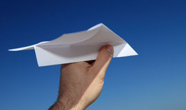 Person holding paper plane Stock Images