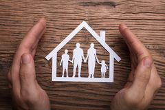 Person Holding Protective Hand On Family Home stock photos