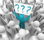 Person Holding Question Mark Sign In Crowd Stock Images