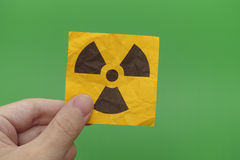 Person holding Radiation warning sign in his hand Stock Photography