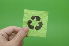Person holding Recycle Symbol in his hand. Go green concept image Stock Photo