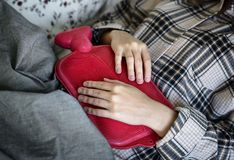 Person Holding Red Hot Compress Stock Image