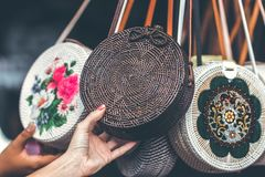 Person Holding Round Black Wicker Crossbody Bag royalty free stock photography