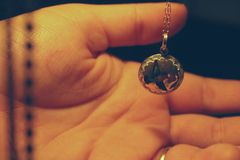 Person Holding Round Silver-colored Necklace Pendant Stock Photography