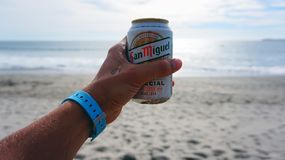 Person Holding San Miguel Beer Tin Can Royalty Free Stock Photography