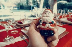 Person Holding Santa Claus Figurine Royalty Free Stock Image