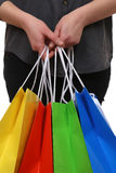 Person holding shopping bags Royalty Free Stock Photo