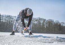 Person Holding Shovel on Snow Field stock photo