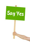 Person holding sign saying Say yes Royalty Free Stock Image