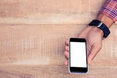 Person holding smart phone on desk Royalty Free Stock Photography