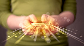 Person holding smarthphone with technology light applications Royalty Free Stock Image