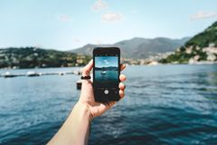 Person Holding Space Gray Iphone 5s Taking Picture of Beach Royalty Free Stock Photo