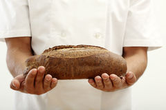Person holding a special loaf of bread Stock Photos
