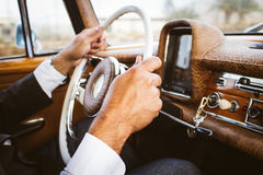 Person Holding a Steering Wheel Holding a Car Stock Photo