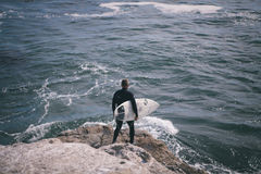 Person Holding Surfing Board Standing Cliff Beside Sea Royalty Free Stock Photos