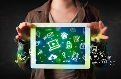 Person holding tablet with green media icons and symbols. Person holding tablet pc with green media icons and symbols Royalty Free Stock Photo