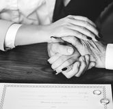 Person Holding Their Hands on Brown Wooden Table Royalty Free Stock Photos