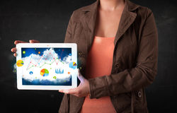 Person holding a touchpad with cloud technology and charts Royalty Free Stock Images