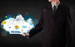Person holding a touchpad with cloud technology and charts Stock Photos