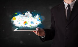 Person holding a touchpad with cloud technology and charts Stock Photography
