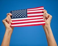 Person holding US flag Stock Photo