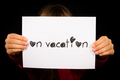 Person holding On Vacation sign Royalty Free Stock Photos
