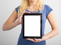 Person holding vertical blank screen tablet royalty free stock photo