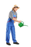 Person with holding a watering can Stock Photos