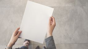 Person holding white empty paper. Person holding white  empty paper Stock Photos