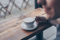 Person Holding White Mug Filled With Coffee Royalty Free Stock Image