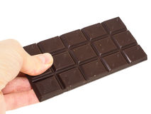 Person holding a whole bar of dark chocolate isolated Stock Photo