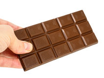Person holding a whole bar of light chocolate Stock Photos