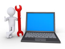 Person is holding wrench beside a computer. 3d person with a wrench is standing beside an opened laptop Royalty Free Stock Image