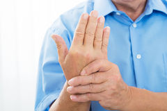 Person Holding Wrist royalty free stock image