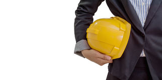 Person holding yellow helmet for workers security on white background Royalty Free Stock Photography