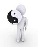 Person holding yin-yang symbol. Person is holding a yin-yang symbol in his hand Royalty Free Stock Photos