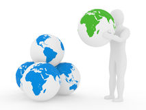 The person holds a planet the earth on arms Royalty Free Stock Photo