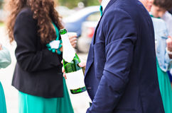 The person holds a wine bottle in a hand royalty free stock image