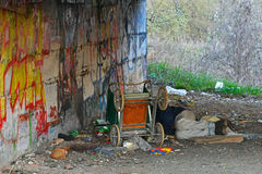 Person is homeless. And sleeps under the bridge Royalty Free Stock Photo