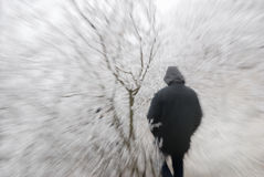 Person in hood in frozen nature Stock Photos