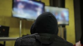 Person with hood playing video game, gamer tournament, free time and hobby. Stock footage stock video footage