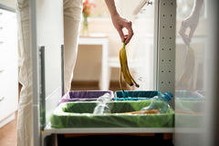 Person in the house kitchen separating waste. Royalty Free Stock Photography