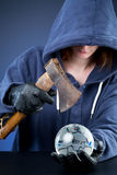 Person hurting the world. A conceptual image with a person about the break a glass globe of the world with an axe Stock Images